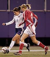 """Denmark's Gitte Andersen marks Mia Hamm. The US Women's National Team tied the Denmark Women's National Team 1 to 1 during game 8 of the 10 game the """"Fan Celebration Tour"""" at Giant's Stadium, East Rutherford, NJ, on Wednesday, November 3, 2004.."""