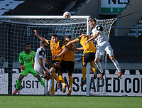 Fulham's Maxime Le Marchand (right) battles with Wolverhampton Wanderers' players<br /> <br /> Photographer David Horton/CameraSport<br /> <br /> The Premier League - Wolverhampton Wanderers v Fulham - Sunday 4th October 2020 - Molineux Stadium - Wolverhampton<br /> <br /> World Copyright © 2020 CameraSport. All rights reserved. 43 Linden Ave. Countesthorpe. Leicester. England. LE8 5PG - Tel: +44 (0) 116 277 4147 - admin@camerasport.com - www.camerasport.com
