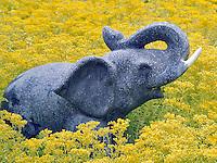 Elephant schulpture in garden.