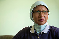 Yogyakarta, Java, Indonesia.  Middle-aged Indonesian Woman, a Tour Guide.