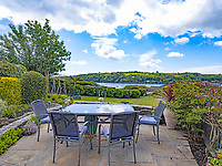 BNPS.co.uk (01202) 558833. <br /> Pic: LillicrapChilcott/BNPS<br /> <br /> Pictured: Garden terrace. <br /> <br /> This impressive waterfront home with breath-taking views is the perfect property for a wannabe sailor - on the market for £2.5m.<br /> <br /> Huefield sits in an elevated position looking over the rooftops of neighbouring properties onto the beautiful Helford River in Cornwall - ideal for watching boats coming and going.<br /> <br /> The Helford Passage area is so sought after houses rarely come up for sale and this one, on the market with Lillicrap Chilcott, is the only property available there at the moment.<br /> <br /> The five-bedroom home is south facing and has a swimming pool and beautiful gardens for enjoying the view, as well as access to a gate with a right of way down to the water.