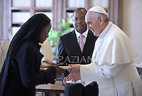 Pope Francis receives  Mozambique's Prime Minister Alberto Vaquina at the end of a private audience in his private library at the Vatican on  April 11, 2013.