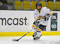 25 October 2008: University of Vermont Catamount forward Sarah Ellins, a Sophomore from Greeley, CO, in action against the Cornell University Big Red at Gutterson Fieldhouse, in Burlington, Vermont. The Big Red defeated the Catamounts 5-1 to sweep their 2-game series in Vermont...Mandatory Photo Credit: Ed Wolfstein Photo