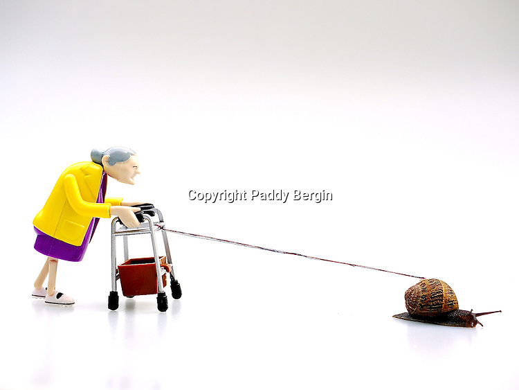 An old lady with a Zimmer Frame is given a tow by a snail.<br />
