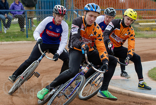 19 APR 2015 - IPSWICH, GBR - Radek Handke (second from left) of Sheffield Stars leads his team mate Pawel Idziorek (right) and Charlie Rumbold (left) and Adam Peck (second from the right) of Ipswich Eagles during a heat of their Elite League cycle speedway fixture at Whitton Sports and Community Centre in Ipswich, Suffolk, Great Britain (PHOTO COPYRIGHT © 2015 NIGEL FARROW, ALL RIGHTS RESERVED)