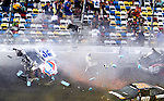 Spectators duck and shield themselves from debris from Kyle Larson's #32 Clorox Chevrolet as it  disintegrates from a wreck on the way to the finish line on the final lap of the NASCAR Nationwide Series DRIVE4COPD 300 auto race at Daytona International Speedway in Daytona Beach, Florida February 23, 2013. Twenty-nine spectators were injured in the stands.<br /> (CREDIT: Mark Wallheiser for UPI Newsphotos) ©2013 Mark Wallheiser