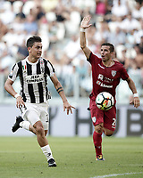 Calcio, Serie A: Torino, Allianz Stadium, 19 agosto 2017. <br /> Juventus' Paulo Dybala (l) in action with Cagliari's Simone Padoin (r) during the Italian Serie A football match between Juventus and Cagliari at Torino's Allianz Stadium, August 19, 2017.<br /> UPDATE IMAGES PRESS/Isabella Bonotto