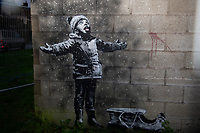 """Pictured: A general view of the Banksy Graffiti in Taibach, Port Talbot, Wales, UK. Wednesday 19 December 2018<br /> Re: The artist Banksy has confirmed that a new graffiti piece that has appeared in south Wales is his.<br /> He used his verified Instagram account to announce: """"Season's greetings' - with a video of the artwork in Port Talbot."""