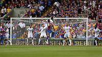 Pictured: Jefferson Montero of Swansea heads the ball away<br />