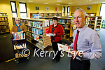 The staff of the county library in Tralee getting ready for their re-opening on Tuesday.<br /> Front right: Tommy O'Connor (County Librarian), Back l to r: Mary Dowling and Veronica Howard.