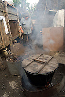 REPUBLIC OF MOLDOVA, Gagauzia, Vulcanesti, 2009/06/30..Pantel Kirilovitch CERNEVES, the stepfather of Viera, prepares cascaval, cheese cooked in the backyard of the house..© Bruno Cogez / Est&Ost Photography..REPUBLIQUE MOLDAVE, Gagaouzie, Vulcanesti, 30/06/2009..Pantele Kirilovitch Cernev, le beau père de Viera, prépare le cascaval, fromage à pâte cuite, dans l'arrière cour de la maison..© Bruno Cogez / Est&Ost Photography