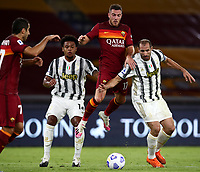 Football, Serie A: AS Roma - Juventus, Olympic stadium, Rome, September 27, 2020. <br /> Roma's Jordan Veretout (c) in action with Juventus' Weston Mckennie (l)  and Giorgio Chiellini (r) during the Italian Serie A football match between Roma and Juventus at Olympic stadium in Rome, on September 27, 2020. <br /> UPDATE IMAGES PRESS/Isabella Bonotto