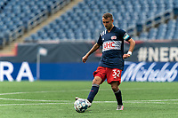 FOXBOROUGH, MA - MAY 12: Jake Rozhansky #32 of New England Revolution II passes the ball during a game between Union Omaha and New England Revolution II at Gillette Stadium on May 12, 2021 in Foxborough, Massachusetts.