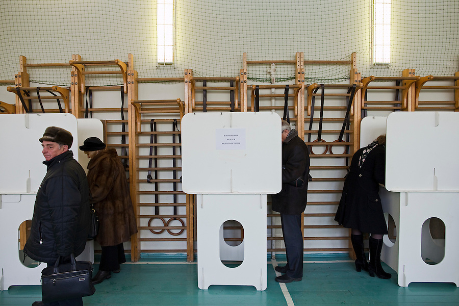 Moscow, Russia, 04/03/2012..Electors write their ballots in a gymnasium as Russians vote in the Presidential election, which Prime Minister Vladimir Putin is expected to win in the first round.