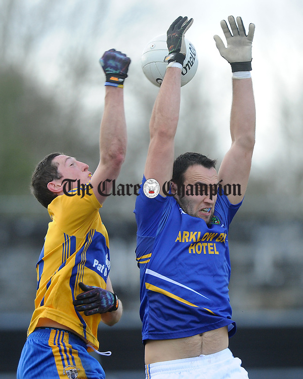 Cathal O Connor of Clare in action against Anthony Mc Loughlin of Wicklow during their National League division 4 round 4 game at Cusack Park. Photograph by John Kelly.