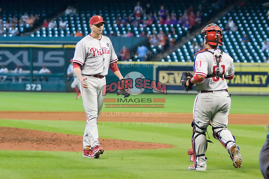 Philadelphia Phillies pitcher Roy Halladay #34 is congratulated by catcher Carlos Ruiz #51 after his complete game win in the Major League Baseball game against the Houston Astros at Minute Maid Park in Houston, Texas on September 14, 2011. Philadelphia defeated Houston 1-0 to clinch a playoff berth.  (Andrew Woolley/Four Seam Images)