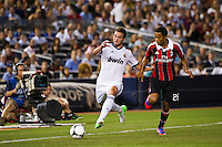 Gonzalo Higuain (20) of Real Madrid is marked by Urby Emanuelson (28) of A. C. Milan. Real Madrid defeated A. C. Milan 5-1 during a 2012 Herbalife World Football Challenge match at Yankee Stadium in New York, NY, on August 8, 2012.