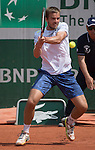 May 27,2016:   Andrei Martin (SVK) loses to Milos Raonic (CAN) 7-6, 6-2, 6-3, at Roland Garros being played at Stade Roland Garros in Paris.  ©Leslie Billman/Tennisclix/CSM