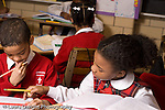 K-8 Parochial School Bronx New York Grade 3 mathematics lesson on measurement using rulers boy and girl working together horizontal