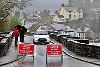 The bridge over river Usk is closed after flooding caused by heavy rain in Crickhowell, south Wales, UK. Saturday 26 October 2019