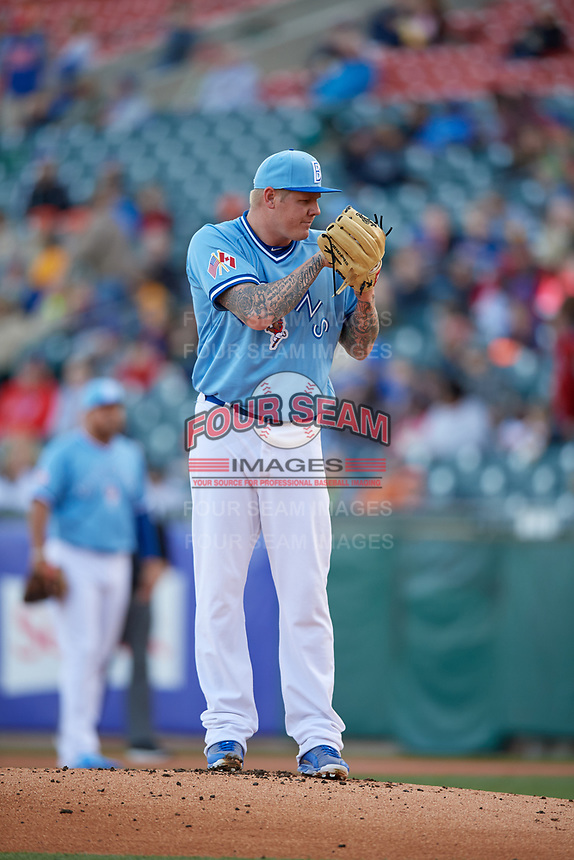 Buffalo Bisons starting pitcher Mat Latos (61) looks in for the sign during a game against the Pawtucket Red Sox on May 19, 2017 at Coca-Cola Field in Buffalo, New York.  Buffalo defeated Pawtucket 7-5 in thirteen innings.  (Mike Janes/Four Seam Images)