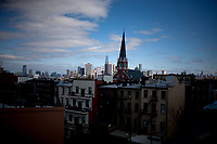 The Lower Manhattan skyline is seen from a Brooklyn rooftop on Saturday, April 5, 2014, in New York. (Photo by James Brosher)