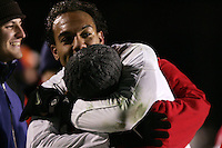 New Mexico's Josh Brown climbed into the stands to celebrate the win with some fans after the game. The University of New Mexico Lobos defeated the Clemson University Tigers 2-1 in a Men's College Cup Semifinal at SAS Stadium in Cary, NC, Friday, December 9, 2005.
