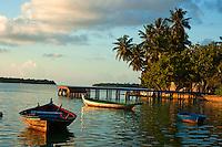 Fishing boats moored near a small wooden jetty, Maldives.
