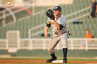 First baseman Luke Murton #34 of the Charleston RiverDogs waits for a throw against the Kannapolis Intimidators at Fieldcrest Cannon Stadium May 29, 2010, in Kannapolis, North Carolina.  Photo by Brian Westerholt / Four Seam Images