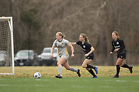 LOUISVILLE, KY - MARCH 13: Julianne Vallerand #26 of West Virginia University and Emina Ekic #13 of Racing Louisville FC chase down the ball during a game between West Virginia University and Racing Louisville FC at Thurman Hutchins Park on March 13, 2021 in Louisville, Kentucky.