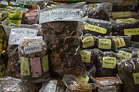 "Yogyakarta, Java, Indonesia.  Traditional Medicine.   ""Sarang Semut Soil from Papua Ants Nests Cures all Cancers.""   Beringharjo Market."