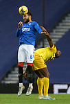 25.10.2020 Rangers v Livingston: Connor Goldson heads clear from Jay Emmanuel-Thomas