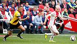 Nederland, Amsterdam, 19 april 2015<br /> Eredivisie<br /> Seizoen 2014-2015<br /> Ajax-NAC Breda (0-0)<br /> Davy Klaassen van Ajax en Demy de Zeeuw van NAC Breda strijden om de bal
