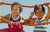 PRESCHOOL IDENTICAL TWINS ON PLAYSCAPE. PRESCHOOL IDENTICAL TWIN BOYS. SAN FRANCISCO CALIFORNIA USA.