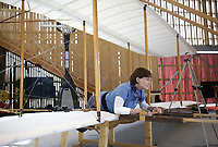 Retired pilot Connie Tobias demonstrates how to fly a 1902 Wright flyer, Monday, April 26, 2021 at the Thaden Barn in Bentonville. Tobias is the only aviator to fly controlled flight in a 1903 Wright flyer exact replica equal to the Wright Brothers flight. Tobias grew up in Dayton, Ohio the birthplace of Aviation and now lives in Kitty Hawk, North Carolina, the state of the first flight by the Wright Brothers. Now retired, she gives educational seminars at different schools with the Wright Brothers Aeroplane Co. of Dayton Ohio. Their visit to the Thaden Barn is their first educational seminar since the start of the pandemic. Check out nwaonline.com/210427Daily/ for today's photo gallery. <br /> (NWA Democrat-Gazette/Charlie Kaijo)