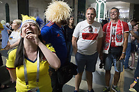KAZAN, RUSSIA - June 23, 2018: A Colombia fan (left) shares a laugh with Poland fans on the way to the FIFA Fan Fest in Kazan before the 2018 FIFA World Cup group stage match between Colombia and Poland at Kazan Arena.