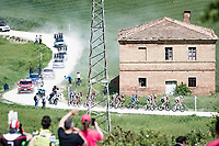 """Extended breakaway group starting gravel sector #1 of teh day.<br /> <br /> 104th Giro d'Italia 2021 (2.UWT)<br /> Stage 11 from Perugia to Montalcino (162km)<br /> """"the Strade Bianche stage""""<br /> <br /> ©kramon"""