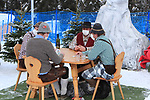 FIS Alpine Ladies Ski World Cup 2021 . Kronplatz, Plan De Corones, Italy on January 26, 2021.  Men wearing traditionals clothes and wearing masks due to pandemic Covid-19 and playing card.