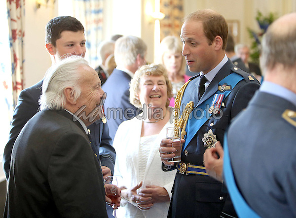 10 July 2015 - London, England - Prince Philip and Prince William during a pre-lunch reception at the RAF Club in central London to mark the 75th anniversary of the Battle of Britain. Photo Credit: Alpha Press/AdMedia