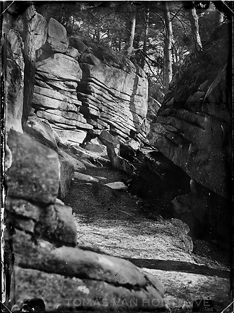 """The footpath passes by """"Le rocher qui tombe"""" (The falling rock) in a section named the La Grande Galerie (The Great Gallery) along Denecourt Trail number 11 East (sentier Denecourt n°11 est, Le Restant du Long Rocher) in the Fontainebleau forest, France. Denecourt gave names to rock formations and other curiosities along the trails he created, often with literary, artistic, historic or mythological references."""