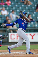Oklahoma City Dodgers outfielder Darnell Sweeney (9) follows through on his swing during the Pacific Coast League baseball game against the Round Rock Express on June 9, 2015 at the Dell Diamond in Round Rock, Texas. The Dodgers defeated the Express 6-3. (Andrew Woolley/Four Seam Images)