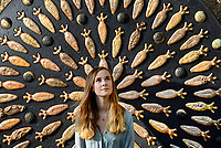 BNPS.co.uk (01202 558833)<br /> Pic: ZacharyCulpin/BNPS<br /> <br /> Cosmic art...<br /> <br /> Sophie Brown pictured with Watts Gallery - Artist Village's latest sculpture, 'Daughters of Theia'.<br /> <br /> The Sculpture by artist Mary Branson celebrates women's relationship to the moon and is made up of 84 ceramic goddesses.<br /> <br /> Watts Gallery – Artists' Village was founded in 1904 and is an art gallery in the village of Compton, near Guildford in Surrey. It is dedicated to the work of the Victorian-era painter and sculptor George Frederic Watts.