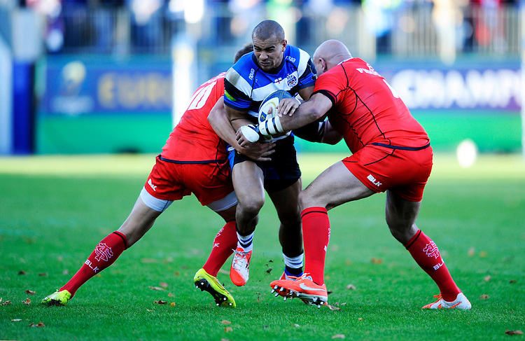 Jonathan Joseph of Bath Rugby is sandwiched between Toby Flood and Gurthro Steenkamp of Stade Toulousain during the European Rugby Champions Cup  Round 2 match between Bath Rugby and Stade Toulousain at The Recreation Ground on Saturday 25th October 2014 (Photo by Rob Munro)