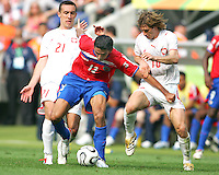 Ireneusz Jelen (21) and Miroslav Szymkowiak (10) of Poland stop Leonardo Gonzalez (12) of Costa Rica. Poland defeated Costa Rica 2-1 in their FIFA World Cup Group A match at FIFA World Cup Stadium, Hanover, Germany, June 20, 2006.