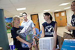 August 20, 2011. Chapel Hill, NC.. American Eagle volunteers (left to right)  Astin Barnes, Pinelopi Kyriazi and Emily Carter, are a few of many American Eagle student volunteers who fanned out around the UNC campus on move in day to raise awareness of the brand by giving out coupons and helping incoming students move in to the dorms.. Many companies have increased their efforts to reach the youth market by employing popular college students to raise the awareness of the brand by peer to peer marketing on campus' around the country.