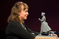 BNPS.co.uk (01202 558833)<br /> Pic: Graham Hunt/BNPS<br /> <br /> Pictured: The scaled-down model of the new statue to honour pioneering palaeontologist Mary Anning. Sculptor Denise Dutton with the model<br /> <br /> Campaigners behind a bid to get a statue of palaeontologist Mary Anning built have accused officials of being dinosaurs for jeopardising the project.<br /> <br /> Evie Swire and her mum Anya Pearson set up a charity and fundraised £150,000 for a tribute to the pioneering fossil hunter in her hometown of Lyme Regis, Dorset.<br /> <br /> They had hoped to unveil the statue in May 2022 - the 222nd anniversary of Mary's birth - but they have hit a wall of bureaucracy after Dorset Council said they are too busy to deal with the plans and the statue was 'not a high priority'.