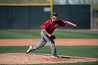 Arizona Diamondbacks relief pitcher Anfernee Benitez (14) follows through on his delivery during a Spring Training game against Meiji University at Salt River Fields at Talking Stick on March 12, 2018 in Scottsdale, Arizona. (Zachary Lucy/Four Seam Images)