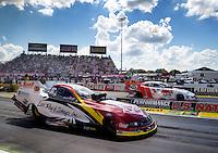 Sept. 2, 2013; Clermont, IN, USA: NHRA funny car driver Tim Wilkerson (near lane) races alongside Jack Beckman during the US Nationals at Lucas Oil Raceway. Mandatory Credit: Mark J. Rebilas-