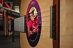 Pictured :  Sara Mela, Curiosity Officer at the Winchester Science Museum and Planetarium, cleans the enormous guitar, a new installation, which will greet visitors.<br /> <br /> At over 10 metres long and 3 metres high, the giant interactive installation allows visitors to explore inside its huge body and listen as sounds produced from the strings reverberate inside.<br /> <br /> The strings of the instrument, made from sailing winches and spearfishing line, will need to be 'tuned' regularly as it gets plucked by visitors.<br /> <br /> The biggest single project undertaken at the Science Centre since opening in 2002, a £1.1million development has seen the entire top floor of the two storey venue completely transformed.<br /> <br /> Designed to coincide with the International Year of Sound 2020 and opening this weekend, other installations include an acoustic sonic rocket and smaller table top exhibits including tuning forks and pendulums.<br /> <br /> © Roger Arbon/Solent News & Photo Agency<br /> UK +44 (0) 2380 458800