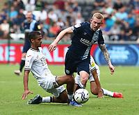 25th September 2021; Swansea.com Stadium, Swansea, Wales; EFL Championship football, Swansea versus Huddersfield; Lewis O'Brien of Huddersfield Town is fouled by Kyle Naughton of Swansea City